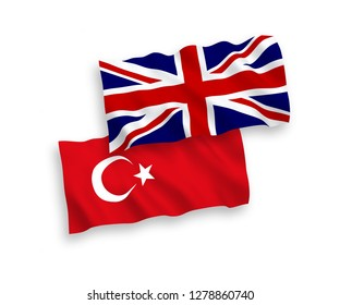 National vector fabric wave flags of Turkey and Great Britain isolated on white background.