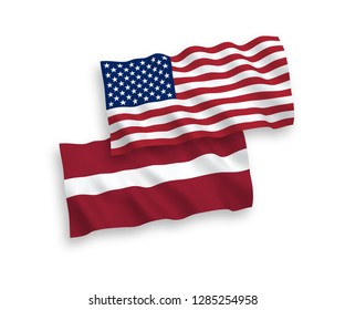 National vector fabric wave flags of Latvia and America isolated on white background.