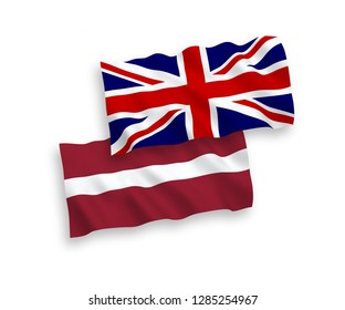 National vector fabric wave flags of Latvia and Great Britain isolated on white background.