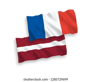 National vector fabric wave flags of France and Latvia isolated on white background.
