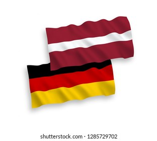 National Vector Fabric Wave Flags Of Germany And Latvia Isolated On White Background.