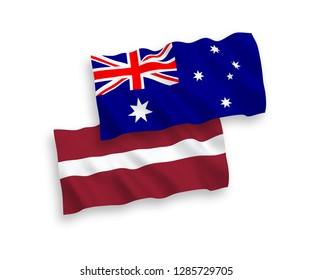 National vector fabric wave flags of Australia and Latvia isolated on white background.