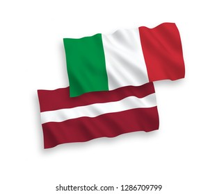 National vector fabric wave flags of Italy and Latvia isolated on white background.