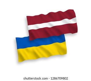 National vector fabric wave flags of Latvia and Ukraine isolated on white background.