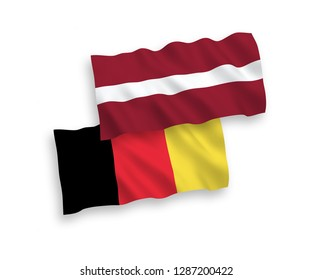 National vector fabric wave flags of Latvia and Belgium isolated on white background.