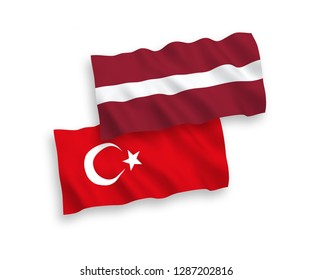National vector fabric wave flags of Turkey and Latvia isolated on white background.