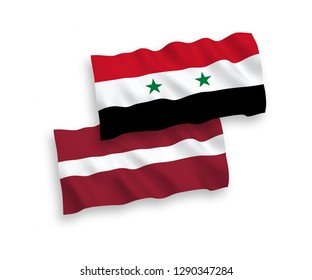National vector fabric wave flags of Latvia and Syria isolated on white background.