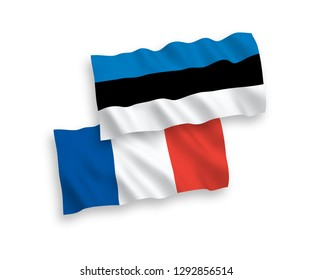 National vector fabric wave flags of France and Estonia isolated on white background.