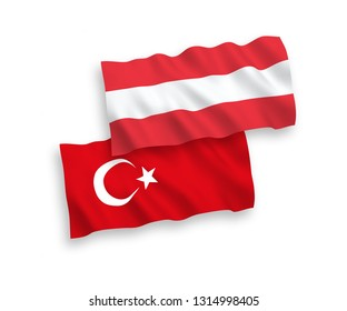 National vector fabric wave flags of Turkey and Austria isolated on white background. 1 to 2 proportion.