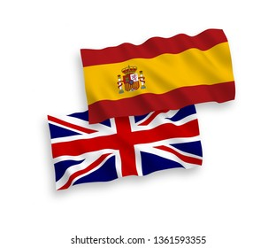 National vector fabric wave flags of Great Britain and Spain isolated on white background. 1 to 2 proportion.