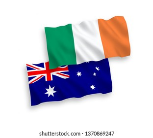 National vector fabric wave flags of Australia and Ireland isolated on white background. 1 to 2 proportion.