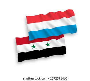 National vector fabric wave flags of Luxembourg and Syria isolated on white background. 1 to 2 proportion.