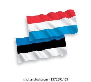 National vector fabric wave flags of Estonia and Luxembourg isolated on white background. 1 to 2 proportion.