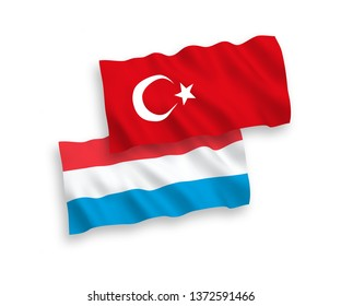 National vector fabric wave flags of Turkey and Luxembourg isolated on white background. 1 to 2 proportion.