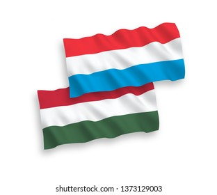 National vector fabric wave flags of Luxembourg and Hungary isolated on white background. 1 to 2 proportion.
