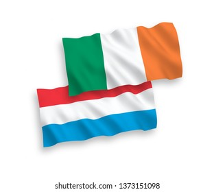 National vector fabric wave flags of Ireland and Luxembourg isolated on white background. 1 to 2 proportion.
