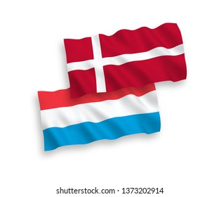 National vector fabric wave flags of Denmark and Luxembourg isolated on white background. 1 to 2 proportion.
