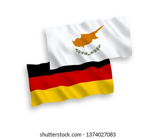 National vector fabric wave flags of Germany and Cyprus isolated on white background. 1 to 2 proportion.