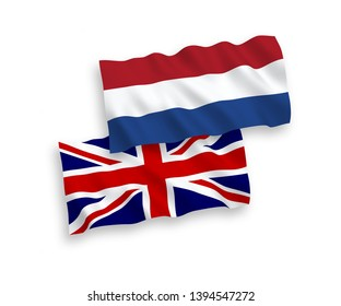 National vector fabric wave flags of Great Britain and Netherlands isolated on white background. 1 to 2 proportion.
