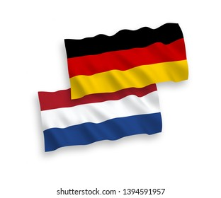 National vector fabric wave flags of Germany and Netherlands isolated on white background. 1 to 2 proportion.