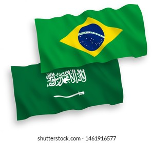 National vector fabric wave flags of Saudi Arabia and Brazil isolated on white background.