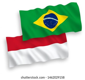 National vector fabric wave flags of Indonesia and Brazil isolated on white background. 1 to 2 proportion.