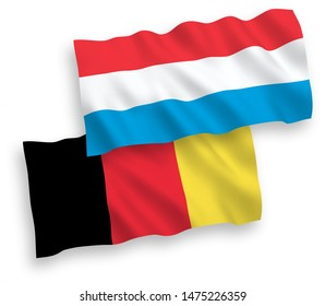National vector fabric wave flags of Luxembourg and Belgium isolated on white background. 1 to 2 proportion.