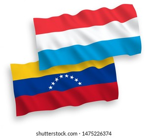 National vector fabric wave flags of Venezuela and Luxembourg isolated on white background. 1 to 2 proportion.