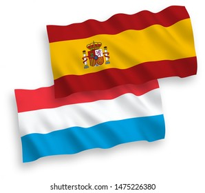 National vector fabric wave flags of Luxembourg and Spain isolated on white background. 1 to 2 proportion.