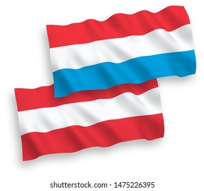 National vector fabric wave flags of Austria and Luxembourg isolated on white background. 1 to 2 proportion.