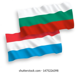 National vector fabric wave flags of Bulgaria and Luxembourg isolated on white background. 1 to 2 proportion.
