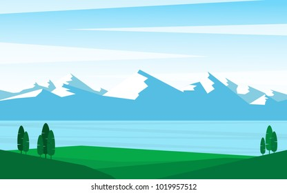 Natural landscape panorama view of mountain range with some pine tree and snowy mountain range with clear blue lake with reflection of natural view in cold winter season with clear blue sky