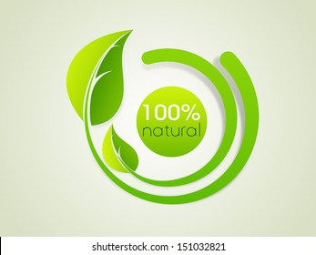 Nature concept with green leaves and text 100% natural.