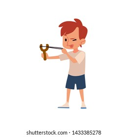 Naughty boy aiming with slingshot with tongue out, cute child with catapult toy making trouble, isolated flat cartoon character doing mischief, hand drawn vector illustration
