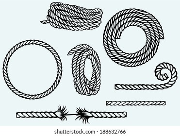 Nautical rope knots. Isolated on blue background