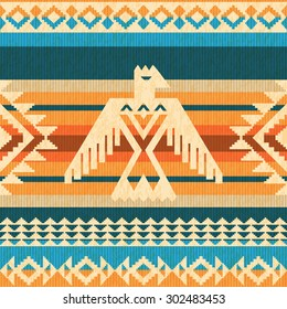 Navajo style abstract seamless pattern with eagle and traditional geometric motifs