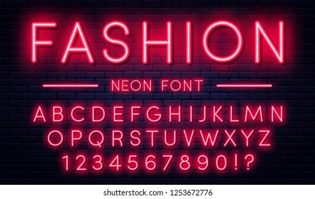 Neon alphabet with numbers. Red neon style font, fluorescent lamps on brick wall background. Vector