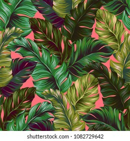 Neon banana leaves pattern. Seamless vector design for wallpaper, fashion, swimwear. Dark green palm leaves on neon pink background.