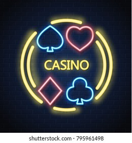 Neon casino sign. Poker, blackjack card suits, spade diamond heart club. Gambling light lamp glowing singage banner advertising template design. Gambling game vector illustration brick wall background