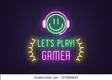 Neon composition of headline Lets Play Gamer. Glowing Neon Emoji with Headphones and text Lets Play Gamer. Bright digital signboard for Gaming industry, Vector. Green, purple and yellow color