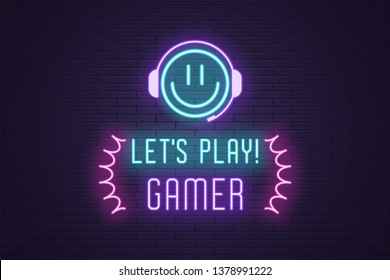 Neon composition of headline Lets Play Gamer. Glowing Neon Emoji with Headphones and text Lets Play Gamer. Bright digital signboard for Gaming industry, Vector. Blue, violet and pink color
