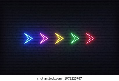 Neon futuristic arrow sign. Set of colorful glowing neon arrow pointer on brick wall background - Shutterstock ID 1972225787