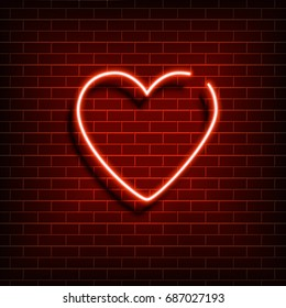Neon heart. A bright red sign on a brick wall. Element of design for a happy Valentine's day. Vector illustration.