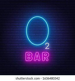 Neon lettering oxygen bar on a dark background.