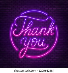 Neon lettering thank you on a dark background.
