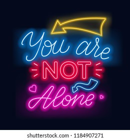 Neon lettering you re not alone. Motivational quote.