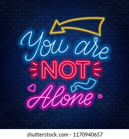 Neon lettering you're not alone. Motivational quote for people in difficult life situation.