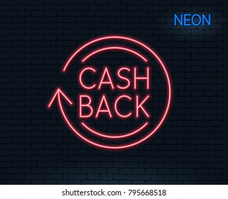 Neon light. Cashback service line icon. Money transfer sign. Rotation arrow symbol. Glowing graphic design. Brick wall. Vector