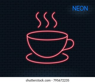 Neon light. Coffee drink line icon. Hot cup sign. Fresh beverage symbol. Glowing graphic design. Brick wall. Vector
