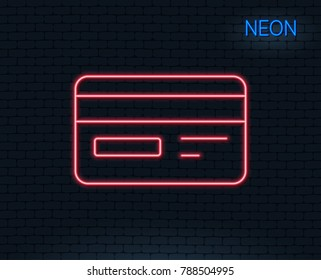 Neon light. Credit card line icon. Bank payment method sign. Online Shopping symbol. Glowing graphic design. Brick wall. Vector